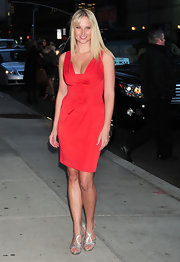 Genevieve Morton looked red-hot in a shirred cocktail dress with a plunging neckline during a visit to 'Letterman.'