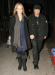 Helen Hunt stayed casual in a pair of gray leather knee high boots. She donned the flat boots with a long coat and chambray dress.
