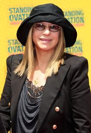 Barbara Streisand paired her black blazer with a black sun hat.