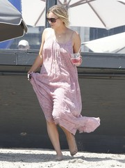 Kaley Cuoco caught some rays wearing a breezy pink sundress during Joel Silver's Memorial Day party.