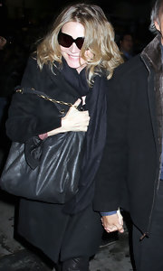 Michelle Pfeiffer carried a black quilted shoulder bag with a gold chain strap to a Lady Gaga concert.