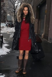 Padma Lakshmi left the 'Katie' show rocking brown rain boots with her red dress and down coat.