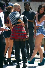 Amber Rose wore a pair of these suspender tights with her school girl skirt on the set of 'School Dance.'