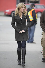 Britt Robertson looked seriously chic in a dark gray wool coat and studded boots on the set of 'The Secret Circle.'