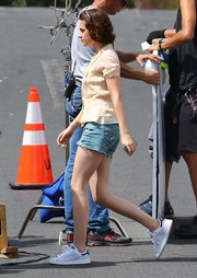 Kristen Stewart stayed comfy in a pair of white tennis sneakers by Adidas while filming her new movie.