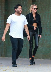 Stella Maxwell flaunted her supermodel figure in black leather skinnies and a cropped jacket while out in New York City.