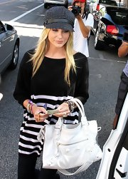 Stephanie Pratt paired her striped shirt and polka dot hat with a white leather shoulder bag.