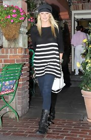 Stephanie looked casual-chic in a loose, striped sweater, skinny jeans and cool, multi-buckled leather boots.