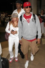 T.I. looked casually cool in a zip up hoodie and a red baseball cap.