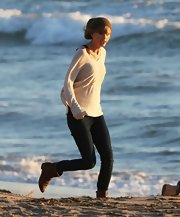 Taylor Swift is a big fan of hats as she showed here when she wore an olive green beanie while filming on the beach.