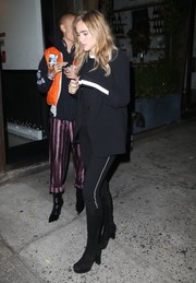 Suki Waterhouse sported a black-on-black blazer and sweatshirt combo while enjoying a night out with Taylor Swift.