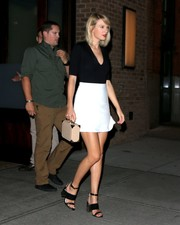 Taylor Swift completed her sleek and chic outfit with a white mini skirt by Related Apparel.