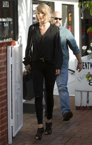 Taylor Swift went shopping wearing a slouchy black blouse by L'Agence.