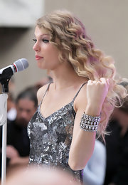 Taylor Swift rocked out on stage on the Today Show in New York. The country crooner paired her sparkling tank dress with matching diamond bracelets. In true Taylor style she completed her look with loose curls.