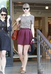 Taylor Swift chose this delicately patterned top with an adorable Peter Pan collar for her daytime look while out in Beverly Hills.
