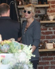 Taylor Swift looked classic and cool wearing these beige-rimmed wayfarers while out shopping.
