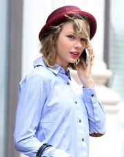 Taylor Swift wore a maroon fedora for some flair to her casual look while out and about in New York City.