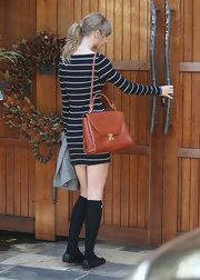 A Mark Cross satchel finished off Taylor Swift's cute, nautical look.