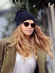 Teresa Palmer accessorized with a blue cable beanie and a pair of sunnies while out in Los Angeles.
