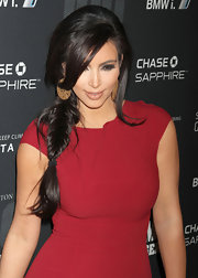 Kim Kardashian wore nude lipstick and smoky eye makeup at the 2011 Game Changer Awards. Her lip color was full-coverage and full-on sexy.