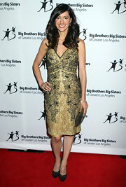 Charlene Amoia topped off her intricate halter cocktail dress with olive green suede pumps.