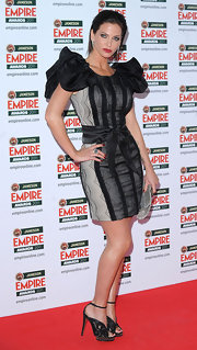 Sarah looked extravagant in a black and gray cocktail dress with exaggerated pouf sleeves at the Empire Film Awards.