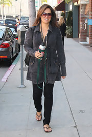 Tia Carrere covered up in a gray denim jacket with princess sleeves in LA.