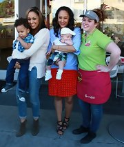 Tamera Mowry's strappy sandals gave her casual mommy style a lift during filming.