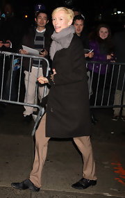 Tilda Swinton maintained her signature androgyny in camel slacks, a black wool coat and a gray scarf.