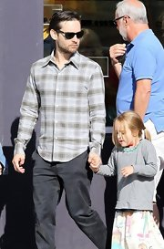 Tobey Maguire stuck to a casual plaid button down for brunch out with this family.