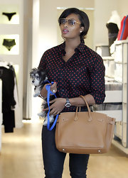 Toccara Jones looked fashionable wearing a pair of gold framed aviators.
