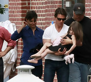 Suri looks cute in these pink ballet slippers.