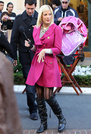 Tori Spelling gave her look an edge with slouchy black knee high boots. Tori donned the buckled leather boots over sheer patterned black tights.