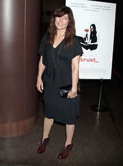 Catherine Keener teamed her tiered dress with wine red leather oxfords.