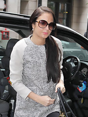 Tulisa Contostavlos left BBC Radio 1 studios in London wearing her ultra-long hair in a low side ponytail.