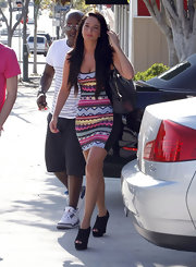 Tulisa topped off her colorful dress with black peep-toe wedges.