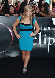 Shawn Johnson got a height boost from the platforms of her strappy metallic sandals. She paired the heels with a vibrant body conscious cocktail dress.