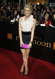 Julianna Hough added a pop of color to her look with a fuchsia Jimmy Choo tube clutch.
