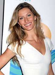 Gisele looked sunkissed and gorgeous with tousled blond curls.