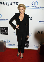 The actress wore a slim-fitting pantsuit with buckled, peep toe pumps.