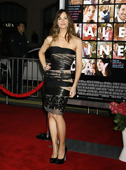 "Miss Garner completed her leather and lace Valentino dress with the popular black leather ""Maniac"" pumps. The sexy style was perfect for this hot look."