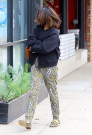 Vanessa Hudgens' olive-green print pants added a vibrant touch.