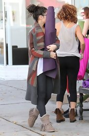 Vanessa Hudgens slipped into a pair of fringed shearling boots after a yoga class.