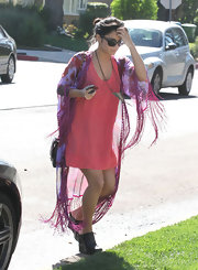 Vanessa Hudgens gave her pink day dress an exotic tough with a fringed silk robe.