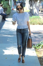 Vanessa Hudgens styled her casual look with a pair of brown By Far mules.