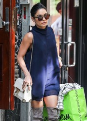 Vanessa Hudgens ran errands in New York City sporting a chic Orka Mesica chain-strap bag and blue romper combo.