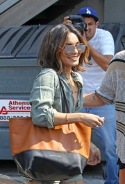 Vanessa Hudgens was spotted at the Nine Zero Salon carrying an oversized two-tone leather tote by Danielle Nicole.