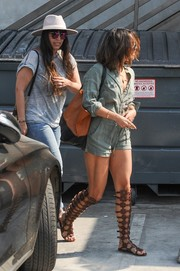Vanessa Hudgens showed off her toned thighs in a sage-colored romper by Rails while visiting the Nine Zero Salon.