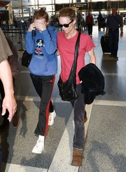 Lily-Rose Depp was casual and cute in a Mickey Mouse hoodie while catching a flight out of LAX.