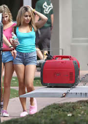 "Vanessa Hudgens showed some skin on the set of ""Spring Breakers"" in short denim shorts and a turquoise tank."